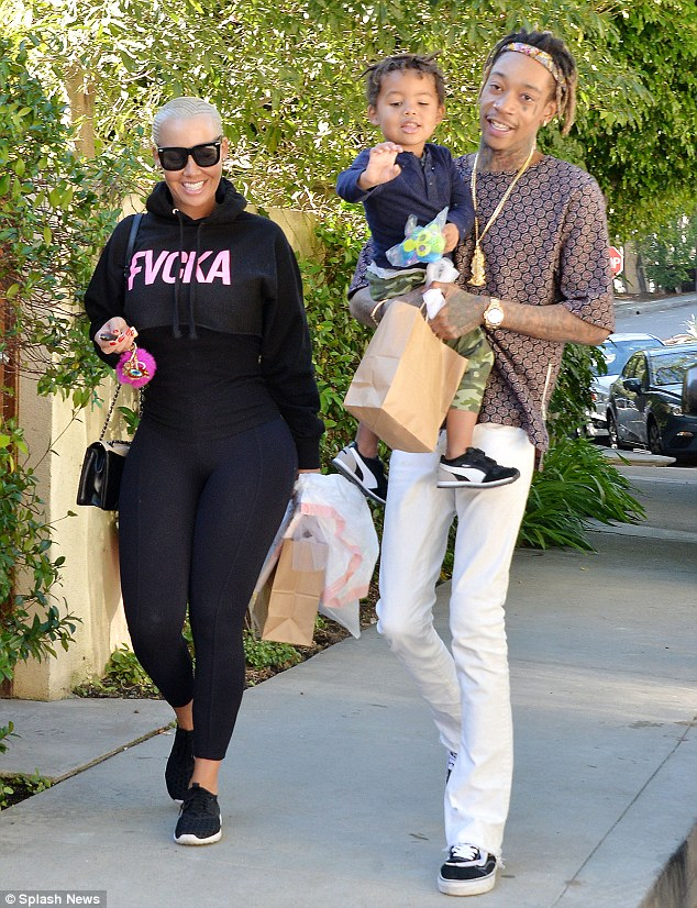 he epic twitter tirade between Kanye and Wiz - referenced the former strippers two-year-old son Sebastian - she is seen here with Wiz and their boy in LA