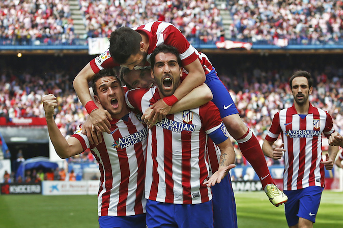 Atletico's Raul Garcia, center right, celebrates his goal with teammates during a Spanish La Liga soccer match between Atletico Madrid and Villarreal at the Vicente Calderon stadium in Madrid, Spain, Saturday, April 5, 2014. (AP Photo/Andres Kudacki)