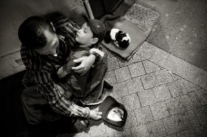 homeless-man-with-child-and-puppy_19-131019